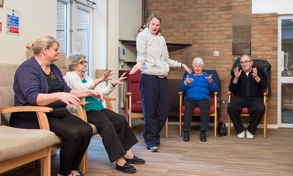 Instructor Hayley Powell leads an exercise course at Spire Home's Crispian Court