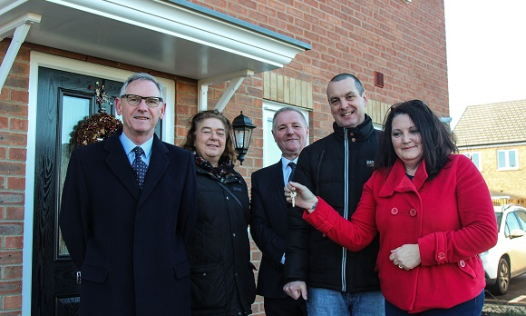 Matthew and Melanie Ronan's get the keys to their new three-bedroom house