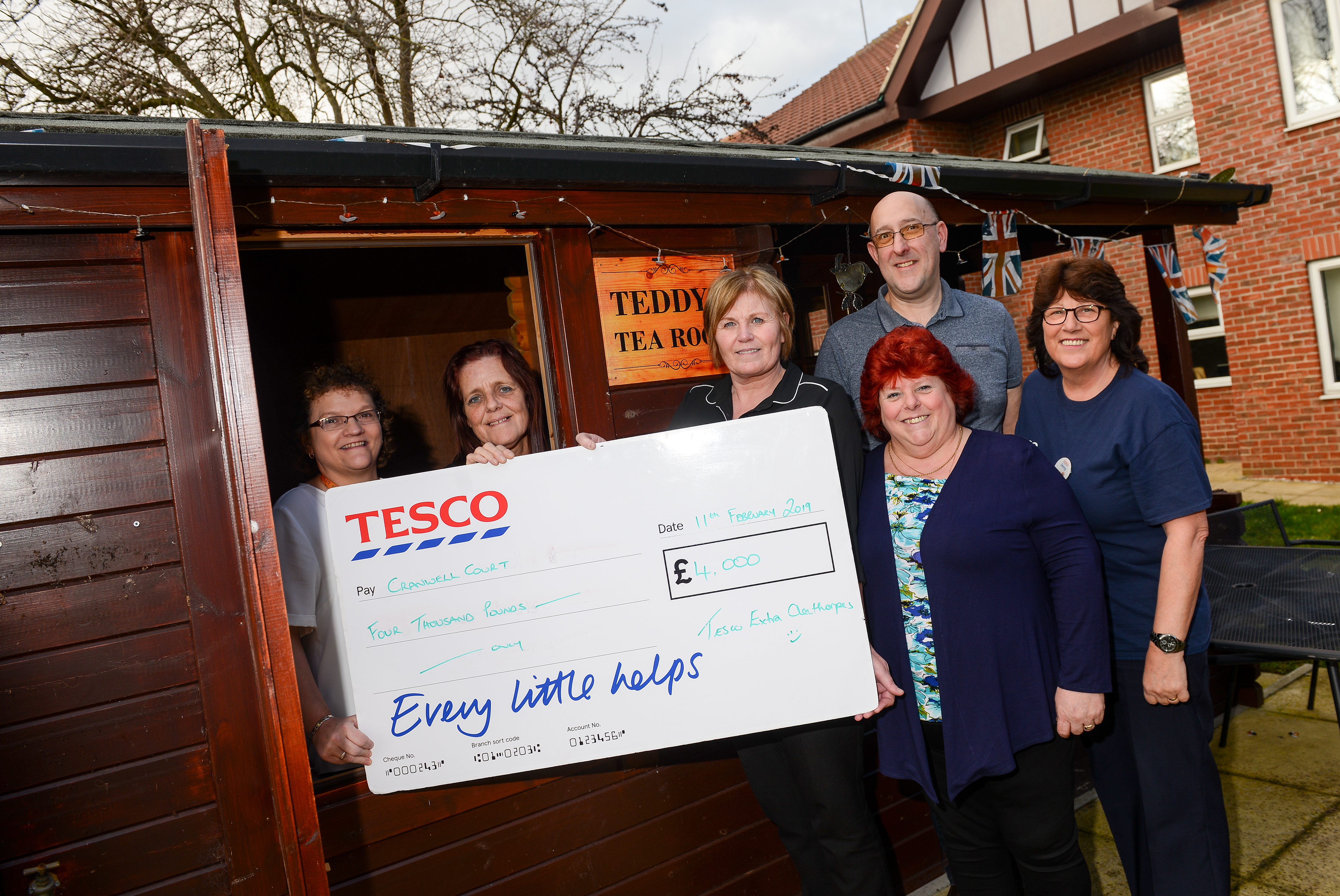Cranwell Court staff receive their donation from Tesco