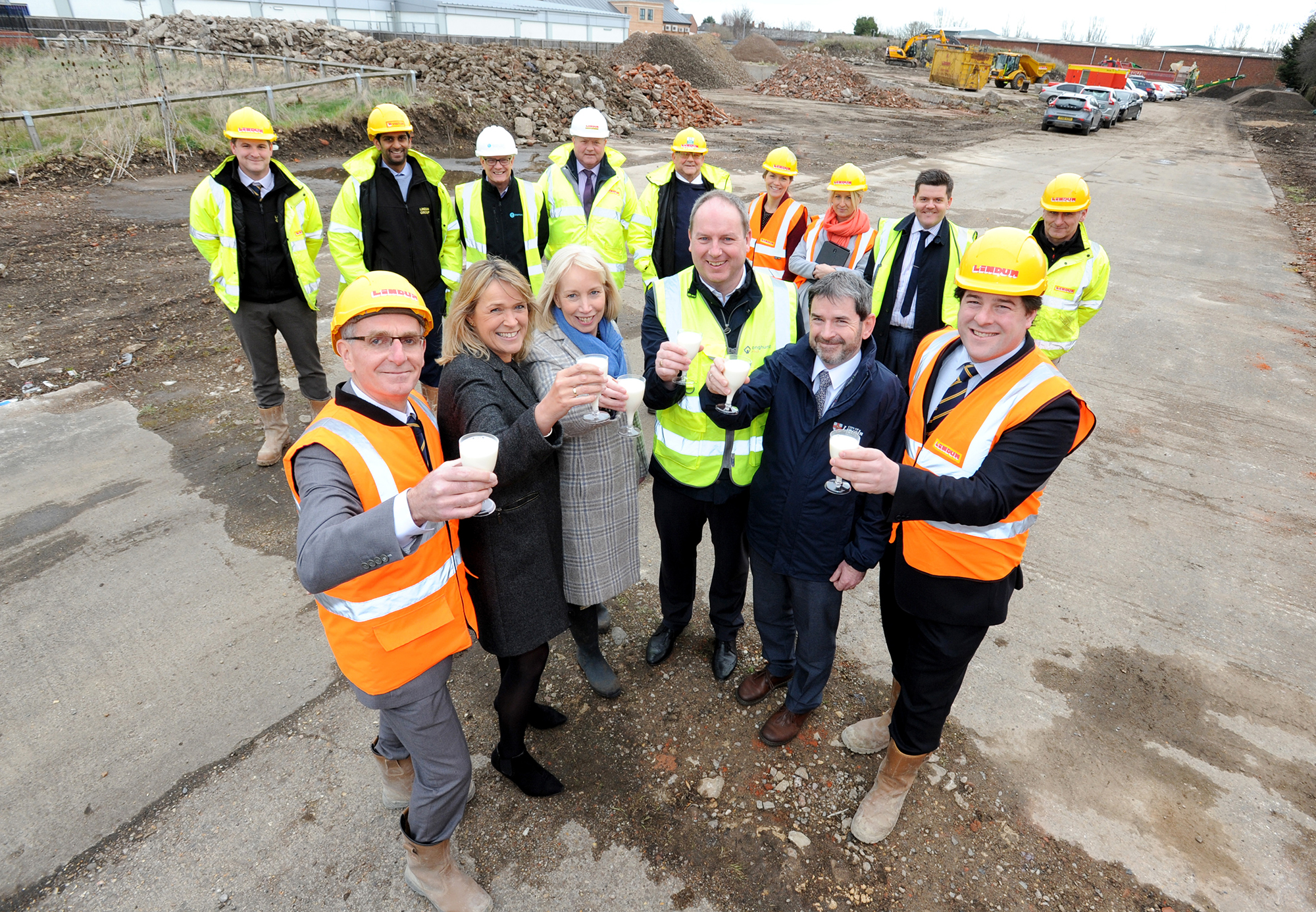 Representatives from Longhurst Group and Lindum Homes toast the start of work on the former Boultham Diary site in Lincoln